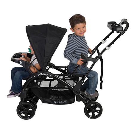 Placing one child in the stroller seat and the other one standing